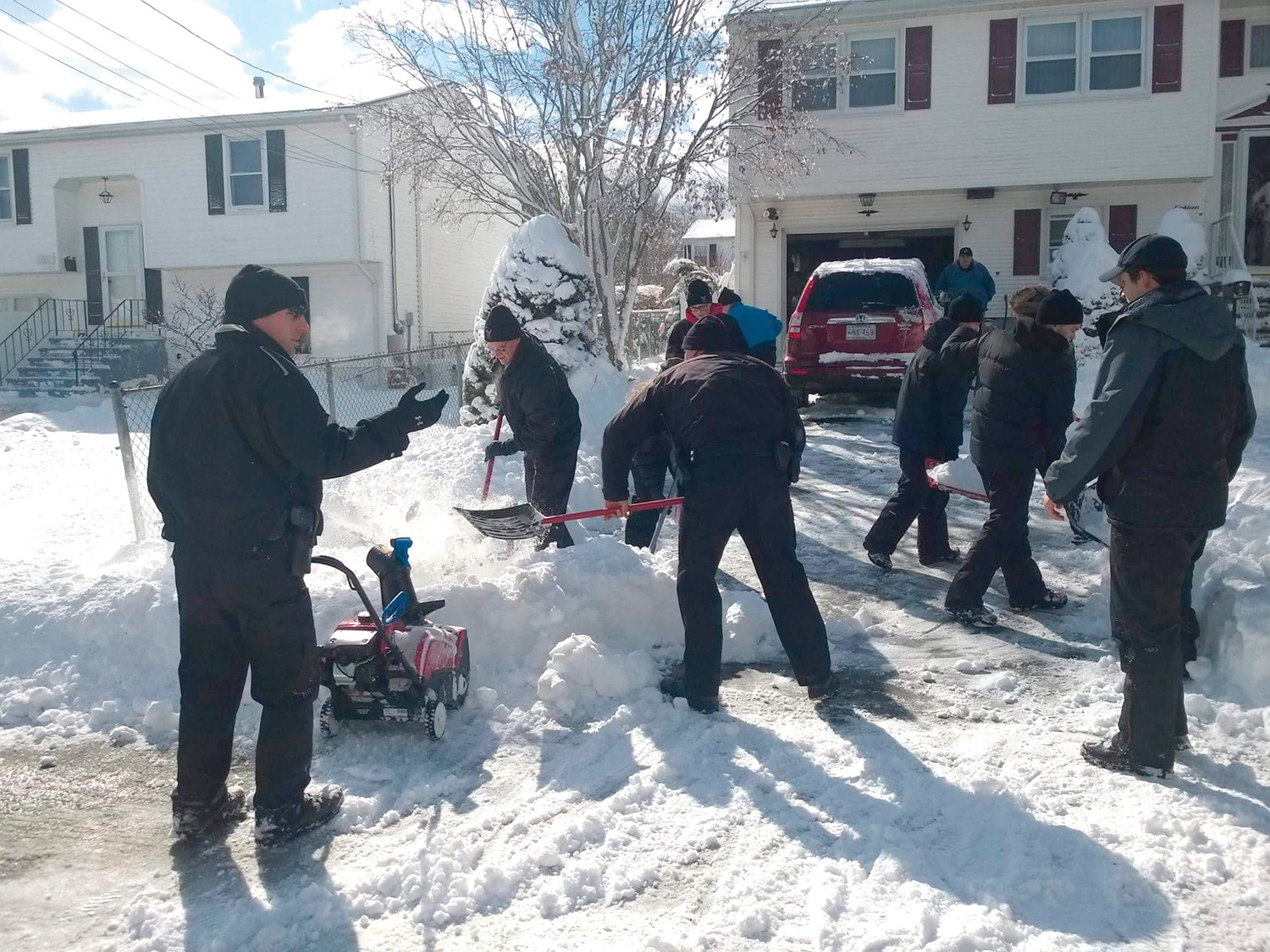 PROUD PATROL: Members of the Johnston Police Explorers Post 405 spent much of Saturday shoveling snow at the homes of elderly and handicapped residents despite temperatures that Major Thomas H. Dolan – the group's coordinator – said dipped below zero due to the wind chill factor. (Submitted photo)