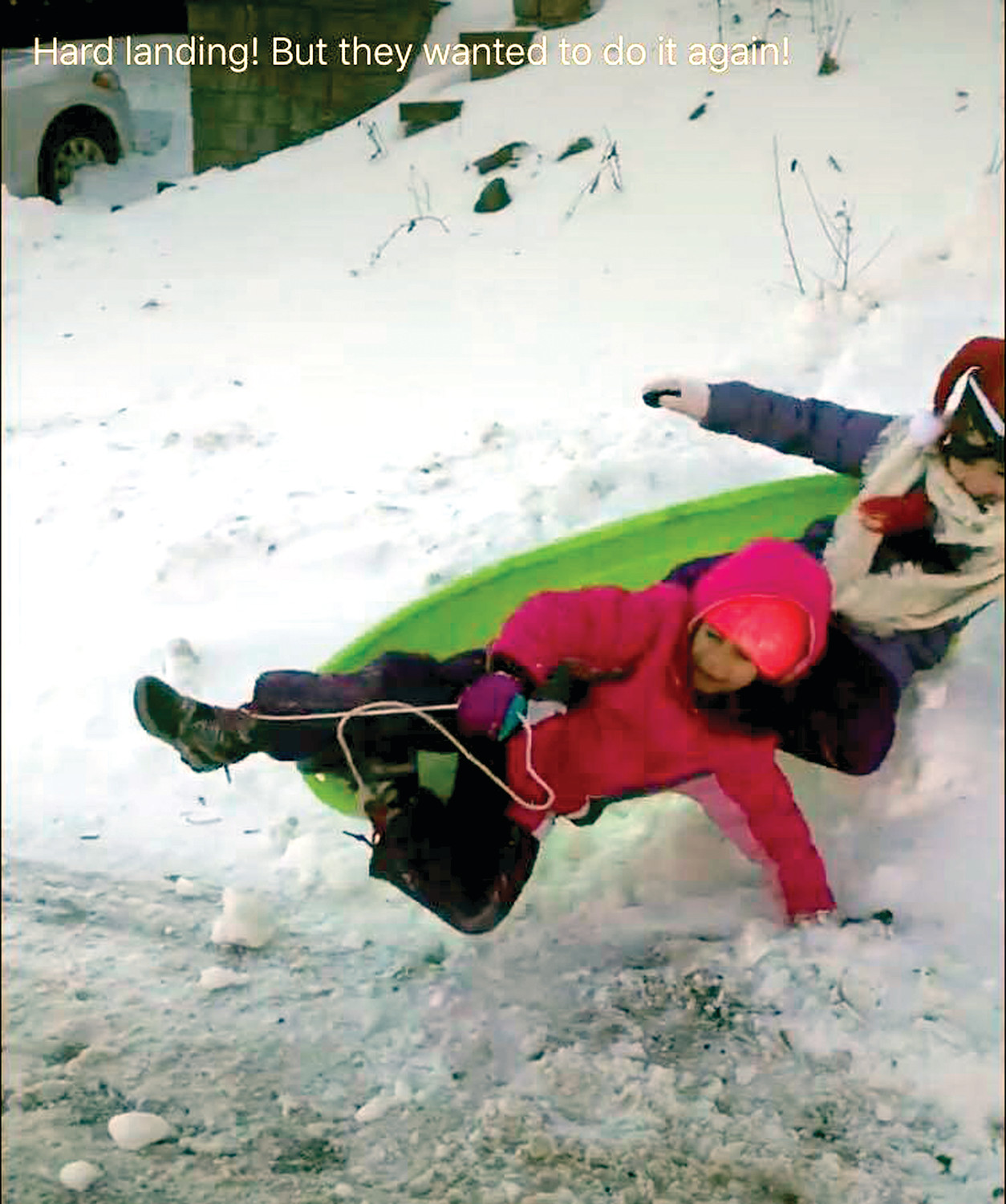 HARD LANDING: Gianna Capraro and Gianna Birri made the most of the snow by hitting the hills with their sled. While they may have wiped out here, it didn't stop them from climbing the hill for another ride. (Submitted photo by Marisa Birri)