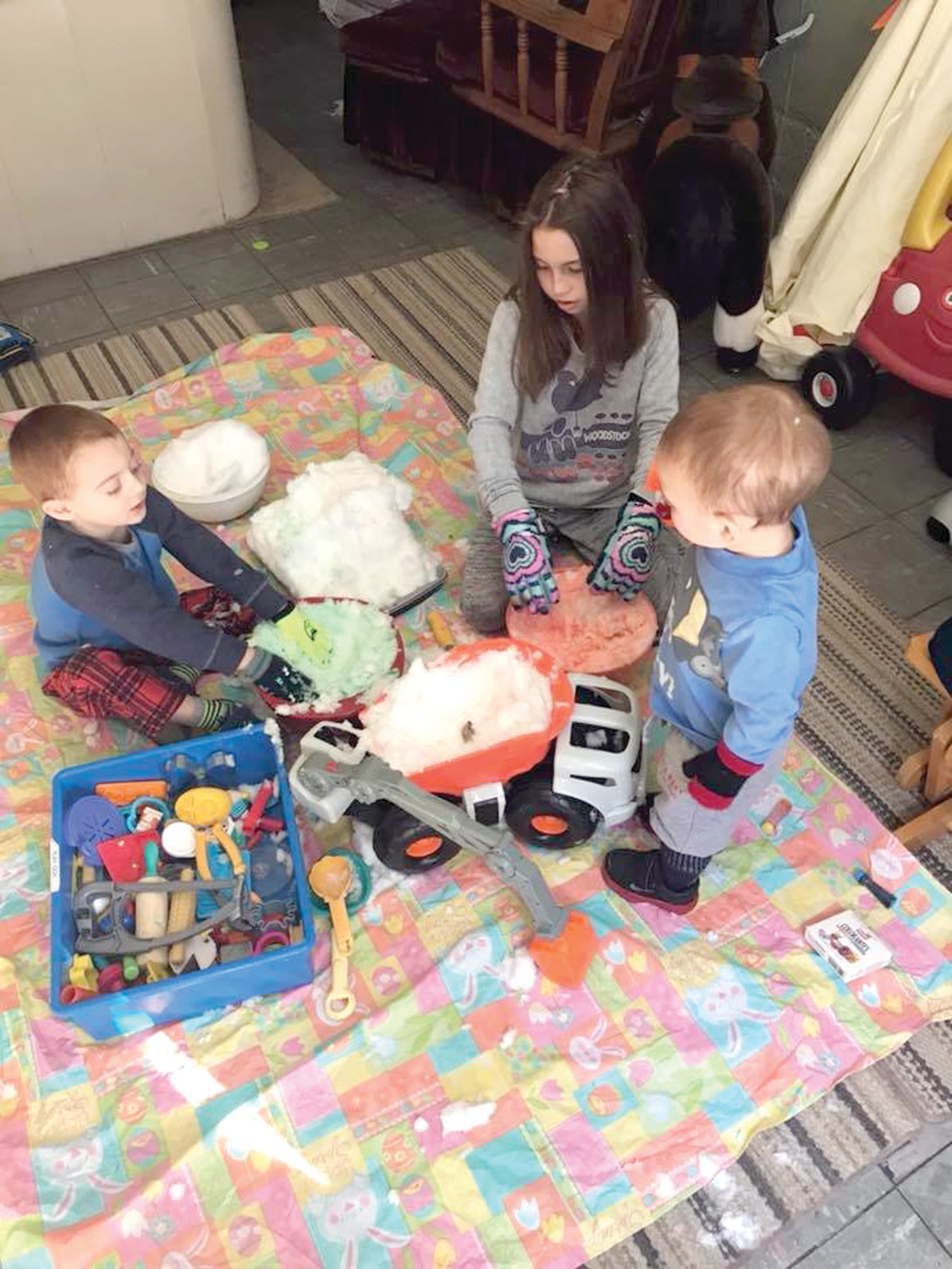 COOL CREATIONS: What are kids to do when they want to play in the snow but it's too cold outside? Bring the snow inside, as Juliana, Lucas and Cole Buscemi did last Friday. (Submitted photo by Caitlyn Buscemi)