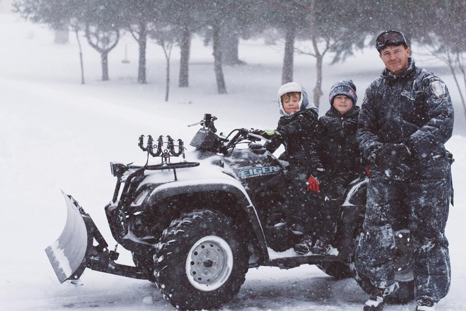 ATV FUN: Tony, Anthony and Emmett LeDoux decided to take a ride during the storm and explore. (Submitted photo by Samantha LeDoux)
