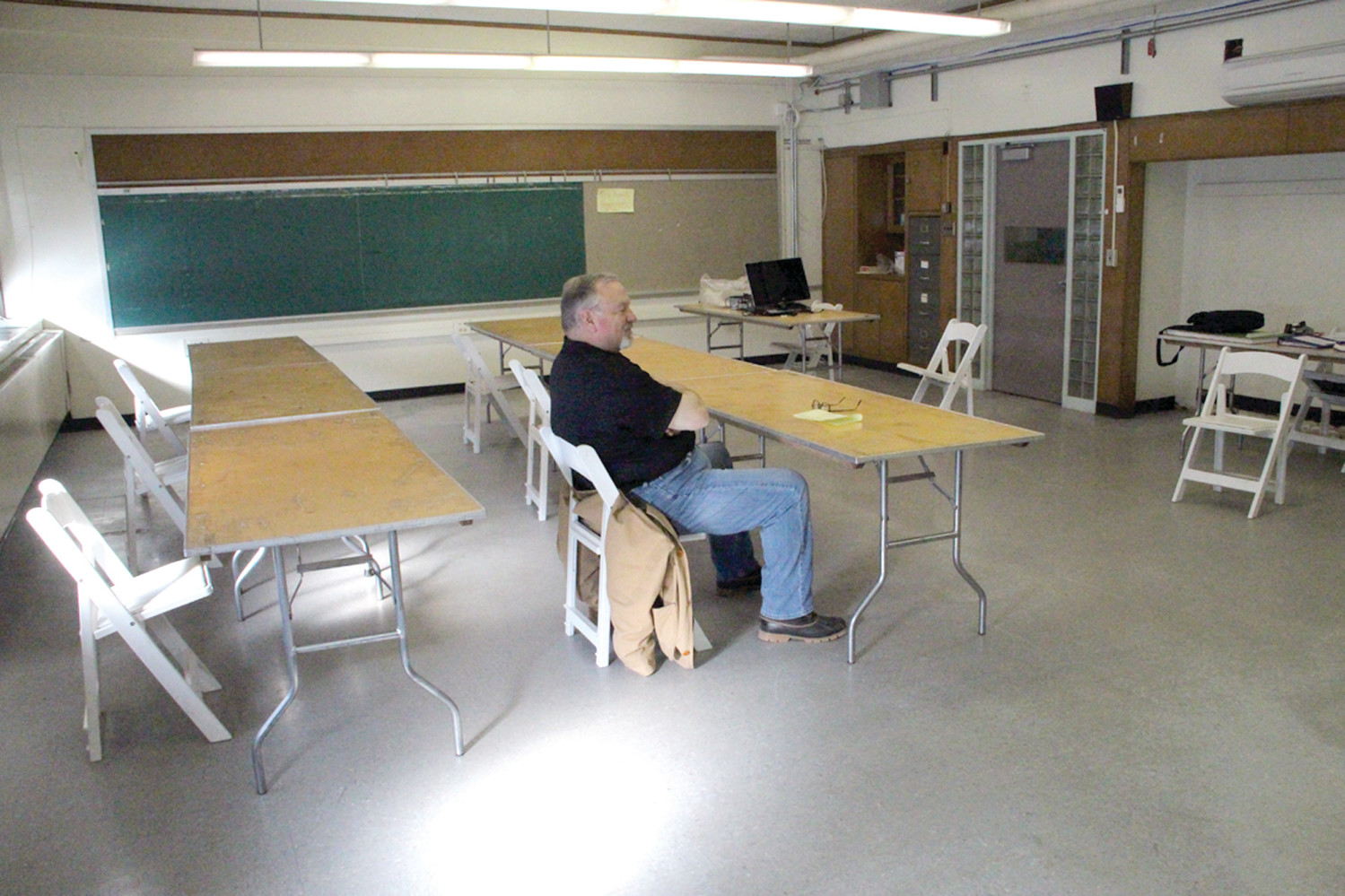 BACK IN CLASS: DPW director Richard Crenca takes a break while assisting with the move of Annex office to Greene School.