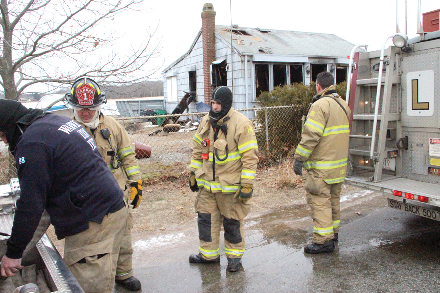 CLEANING UP: Warwick Firefighters prepare to leave the scene of the fire on Sea View Drive Monday morning.