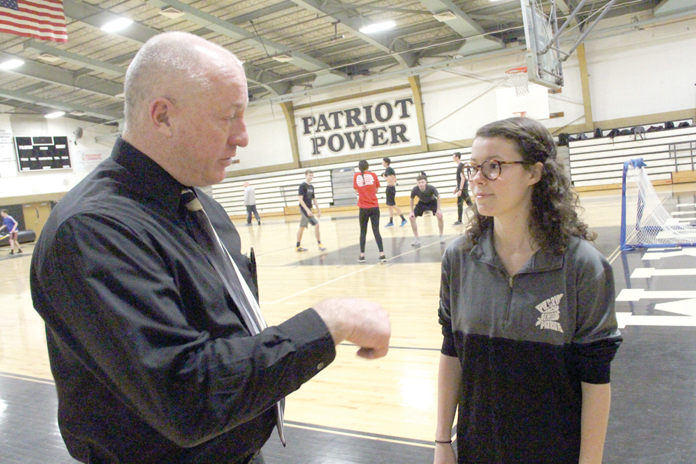 OFF COURT: Pilgrim High Principal Gerald Habershaw and Senior Class President Sophia Kate Carter talk Friday. Sophia is one of two Rhode Island student leaders to be chosen to attend the 56th annual United States Senate Youth Program this March.