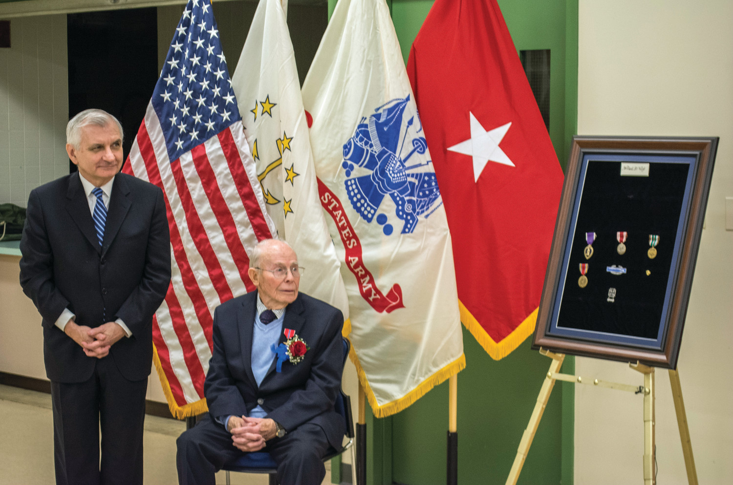 WWII MEDALS: Senator Reed presents Willard Voigt with Bronze Star, Purple Heart, and other medals.