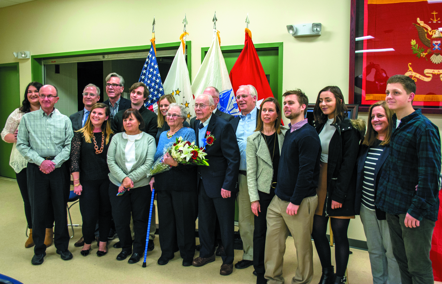 FAMILY OF A VETERAN: Willard Voigt's family proudly joins him as he receives military honors he earned during World War II.
