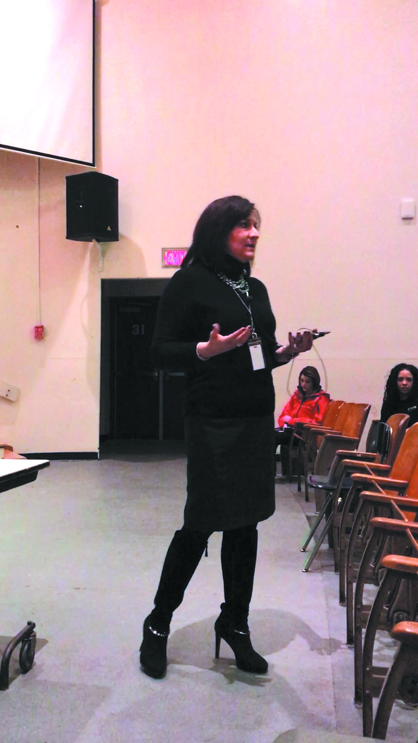 GETTING THE INFORMATION OUT THERE: Cranston Public School's Superintendent Jeannine Nota-Masse addresses the parents, staff and children of Edgewood Highland about the temporary transfer to Norwood Avenue school on January 10.