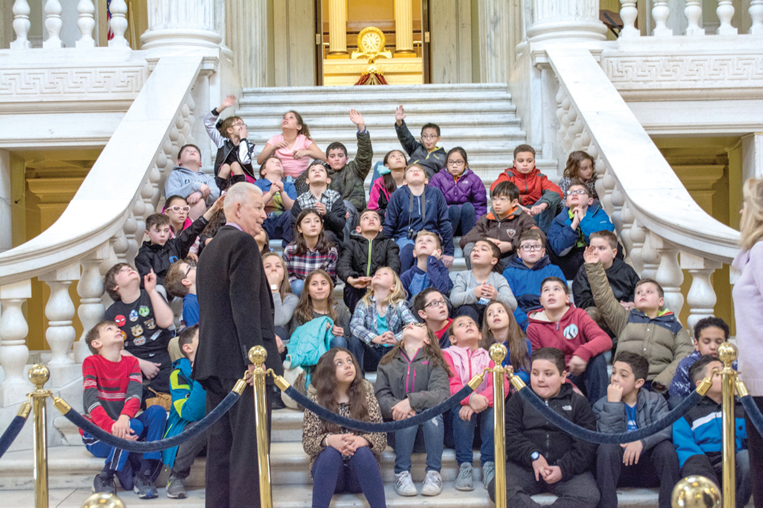 LINING THE STATE HOUSE STAIRS: The 44 students posed with Representative Lancia and his wife MaryAnn before they went off on their tours.