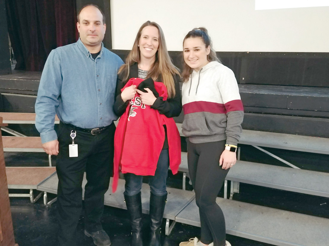 TOKENS OF GRATITUDE: White received school spirit-wear from the members of the SADD club at West and their faculty advisor, Kevin Ascoli. Also pictured is student member Mia Marcello.
