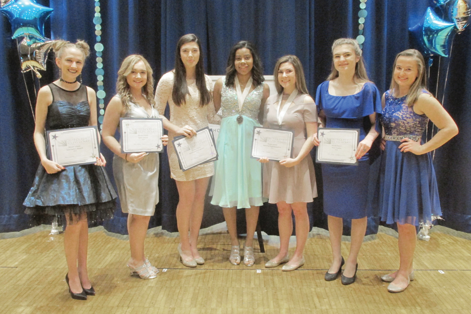 FINALISTS: Tiffany Brooks (center), the 2017 Distinguished Young Women winner, is joined by 2018 finalists Lacy Griffin (left), Exeter-West Greenwich High; Fallon Davis, Johnston High; Madison Freeborn, Scituate High; Viansi Portesi, La Salle; Kaya Giroux, Jacqueline M. Walsh Scholl for the Arts; and Emily Johnston, West Warwick High. (Sun Rise photo by Pete Fontaine)