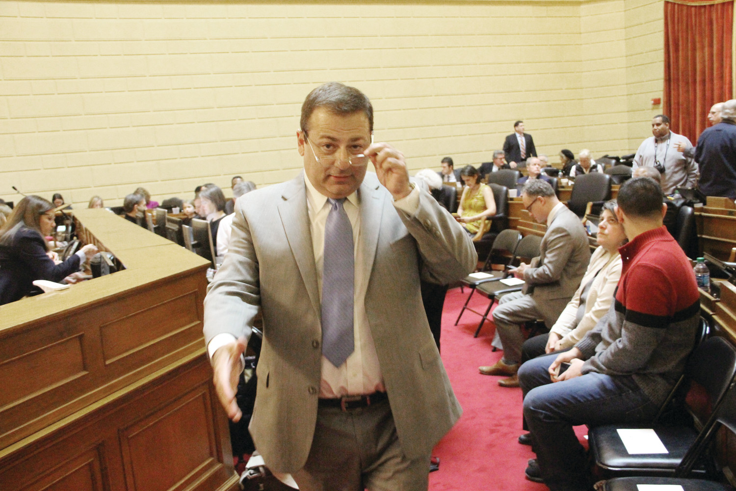 HAND OUT: House Majority Leader K. Joseph Shekarchi extends a welcoming hand as he greets visitors to the House floor Tuesday. (Warwick Beacon photos)