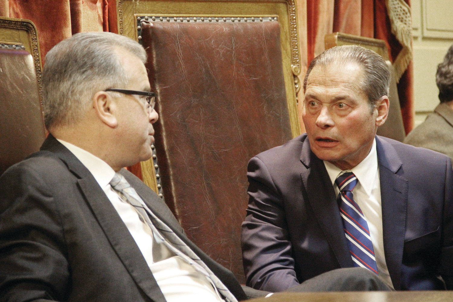 TETE A TETE: House Speaker Nicholas Mattiello and Senate President Dominick Ruggerio, who have been at odds in recent weeks over the proposal to build a PawSox Stadium, confer prior to the governor's arrival at her State of the State address Tuesday.