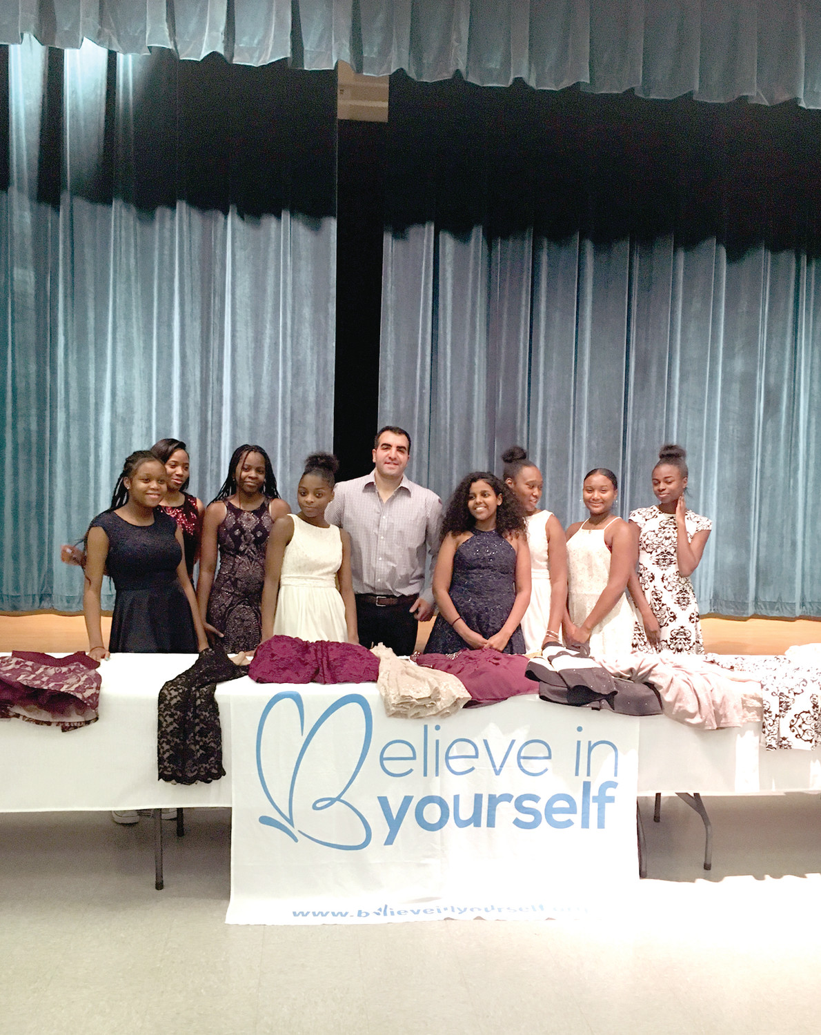A GROWING MISSION: Sam Sisakhti poses with young women from Roxbury, Mass. following a donation event. Sam will be coming to Providence tonight to do an event in Rhode Island for the first, and probably not the last, time.
