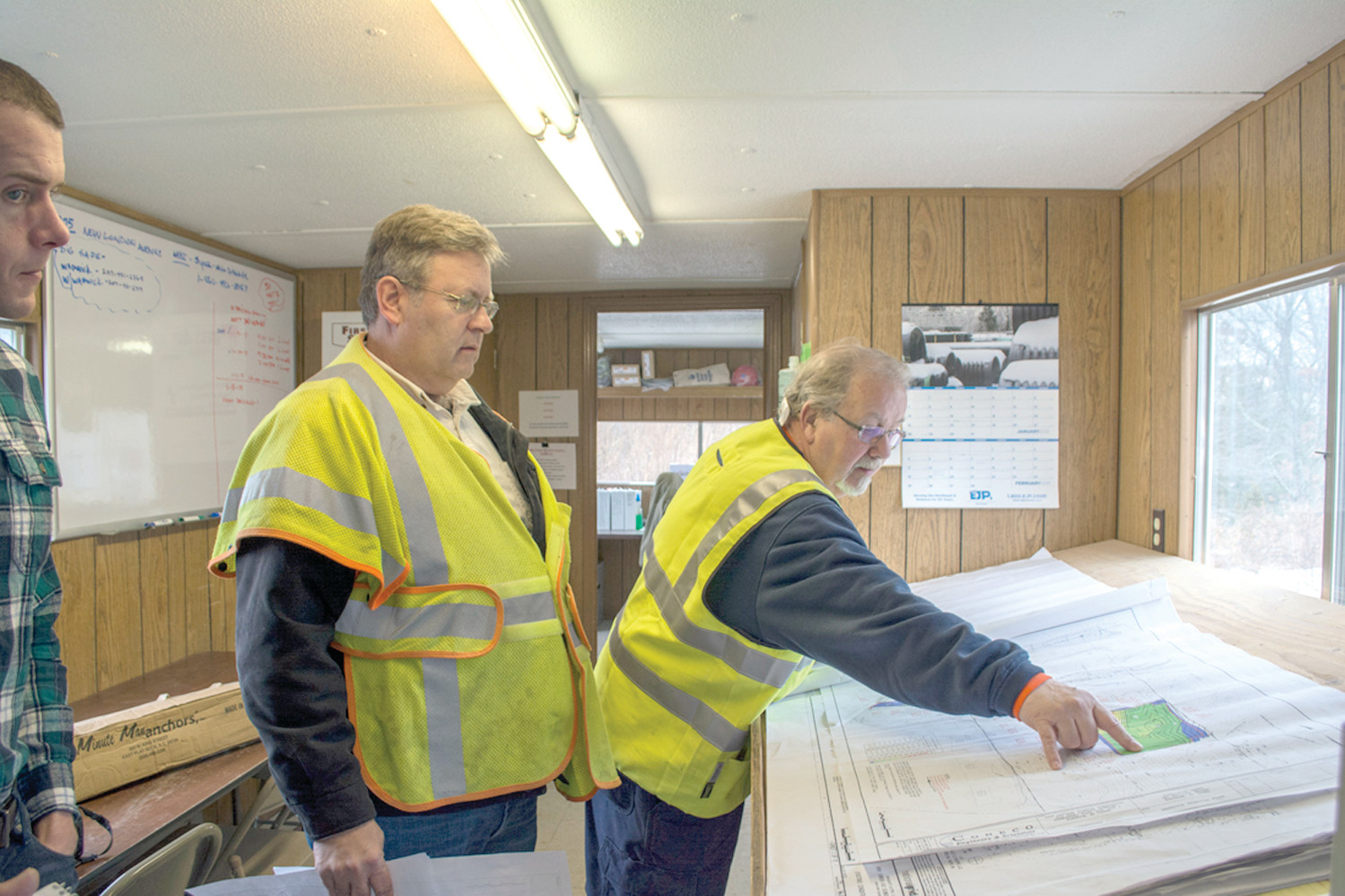 IT'S ALL IN THE PLAN: Daniel McIntyre, principal civil engineer for National Grid and Gary Boyle, site safety officer for Manafort Construction outline construction plans for the electrical substation being built off New London Avenue.