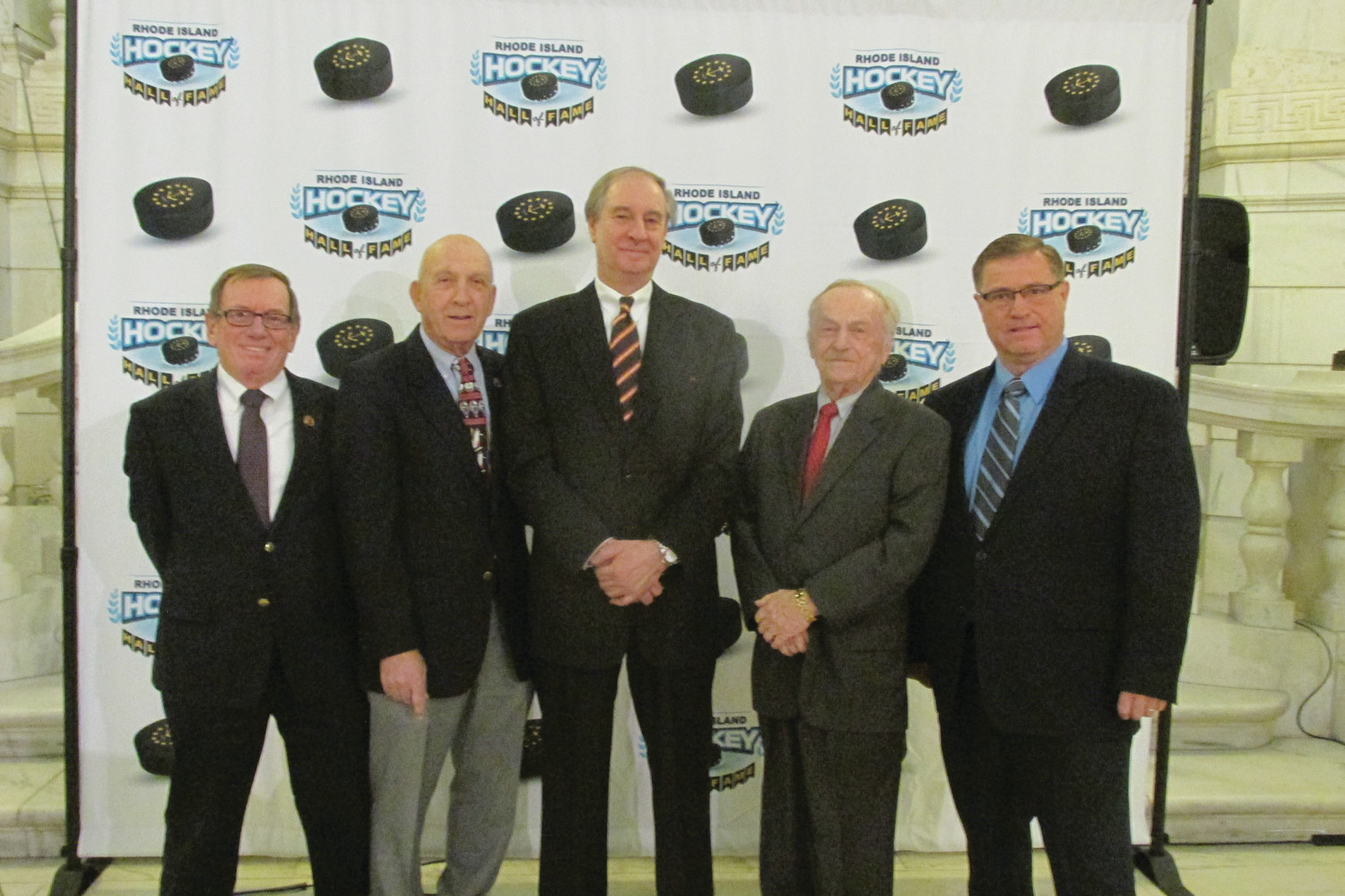 FOUNDING FATHERS: These are five of the nine long-time hockey aficionados who have been working quietly since 2016 and Tuesday announced the establishment of the Rhode Island Hockey Hall of Fame. The group includes, from left: Bill O'Connor, Mal Goldenberg, Chairman Vincent Cimini, Arnold Bailey and Robert Larence. (Sun Rise photos by Pete Fontaine)