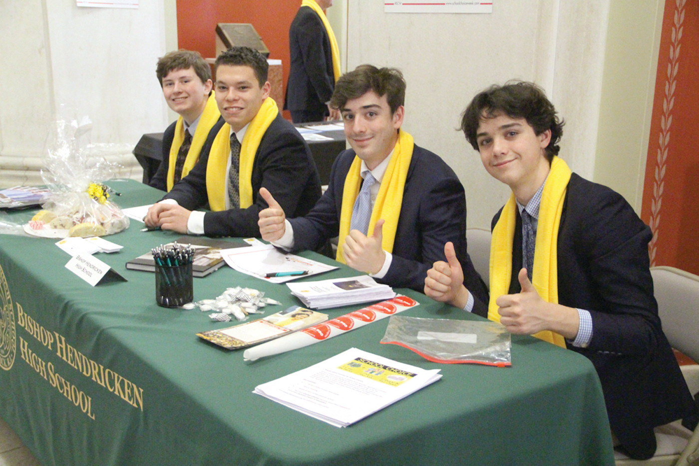 THUMBS UP FOR HENDRICKEN: Hendricken students Tyler Cwiek, Tyler McPhee and brothers Nick and Joseph Weiddinger were present to answer questions about the school.