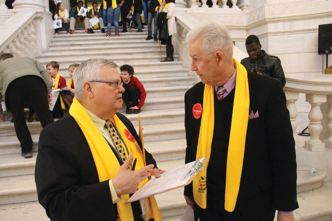 CONFERRING: Edward Bastia, business administrator of the Catholic School office of the Diocese of Providence, and Cranston Rep. Robert Lancia talk about legislation introduced by Lancia that would extend tax credits to no more than $100,000 annually to corporations contributing to scholarship organizations. Tax credits would not exceed $1.5 million in a fiscal year.