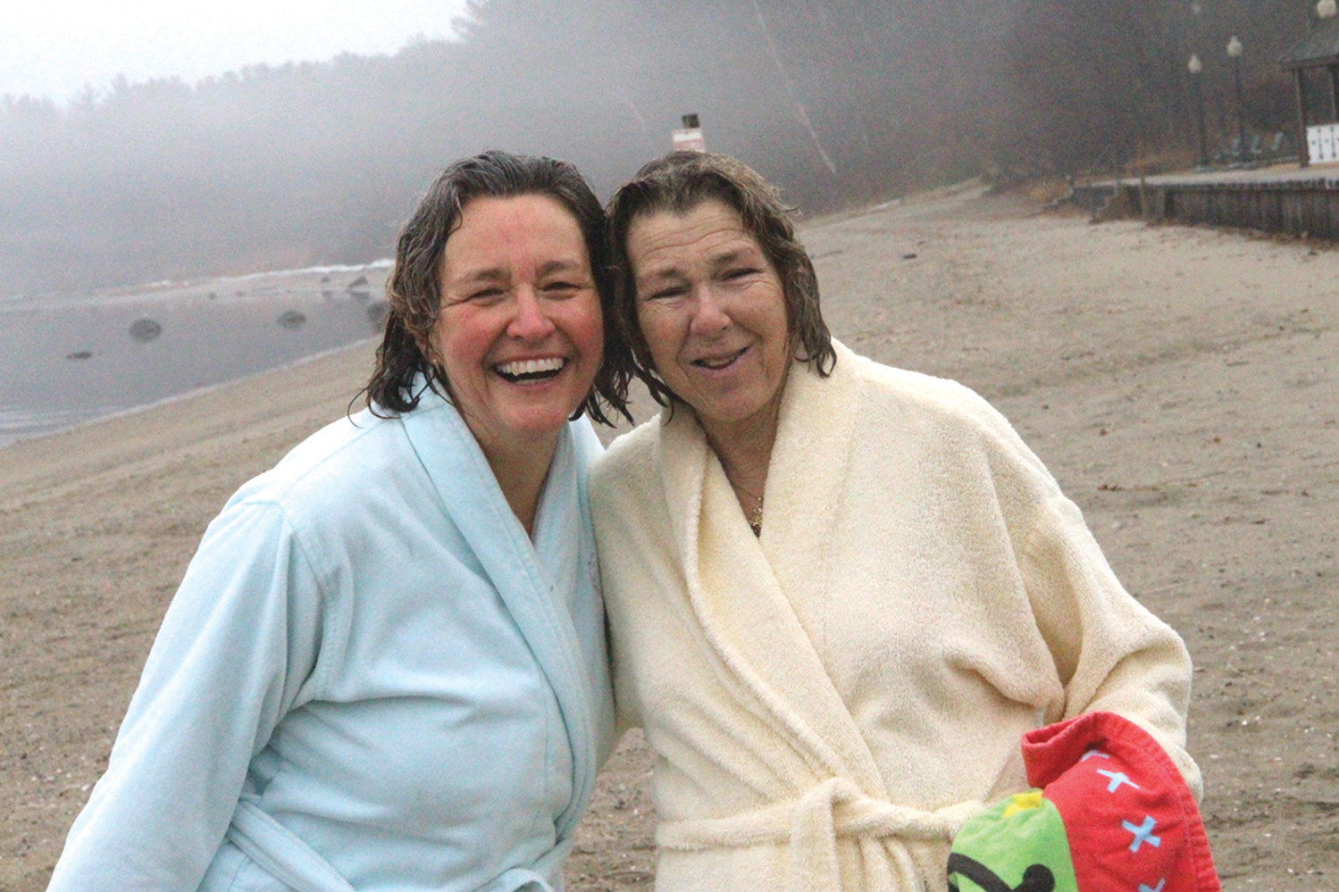 "NOT SO BAD: Mentor RI president and CEO Jo-Ann Schofield and her wife, Sandy Edmundson, took the plunge together. Jo-Ann concluded, ""It feels warmer now than when we went in."""