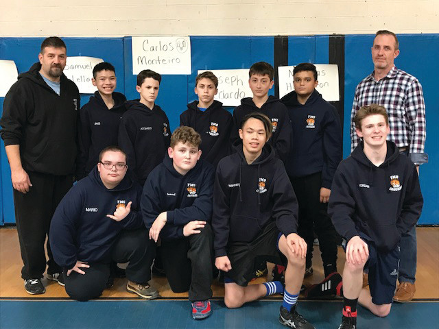 PROLIFIC PERFORMERS: Among those Nicolas A. Ferri Middle School eighth grade wrestlers that enjoyed success during last week's final home dual match and victory vs. Davisville are, in bottom row from left: Mari Pi, Sam McClellan, Nick Harrington and Jordan Gooch. Top: Coach Mario Nasisi, Jake Souvannanvong, Joe Acciardo, Carlos Monteiro, Joe Forte, Ben Jennings and Coach Dan Casey. Below is the full Ferri squad. (Sun Rise photos by Pete Fontaine)