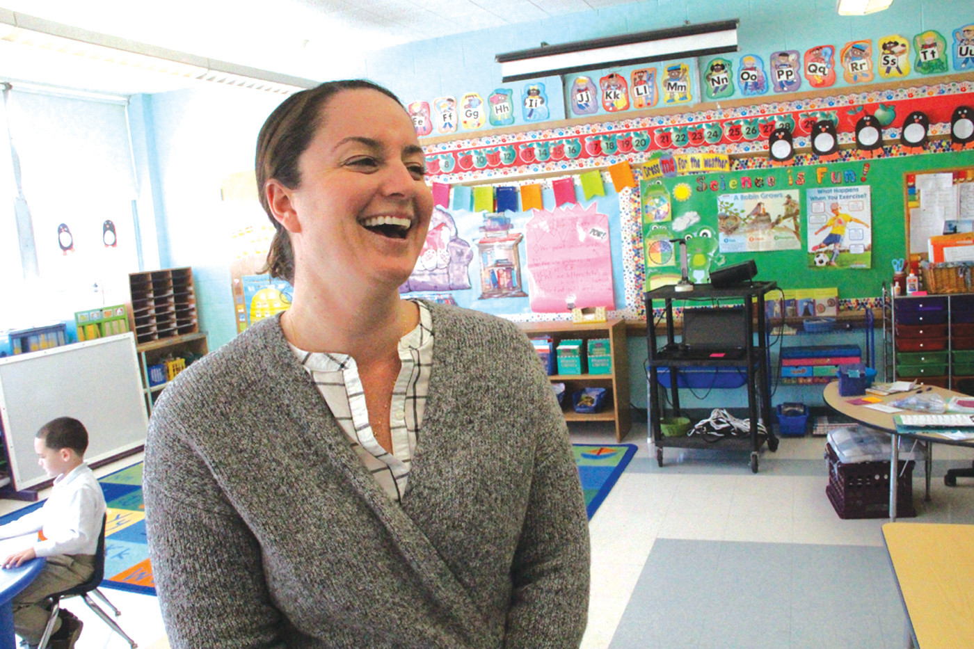 DOING WHAT MAKES HER HAPPY: Heather DeCoccio, kindergarten teacher at St. Kevin School, said that teaching at her alma mater makes her happy, so she doesn't think so much about salary concerns.