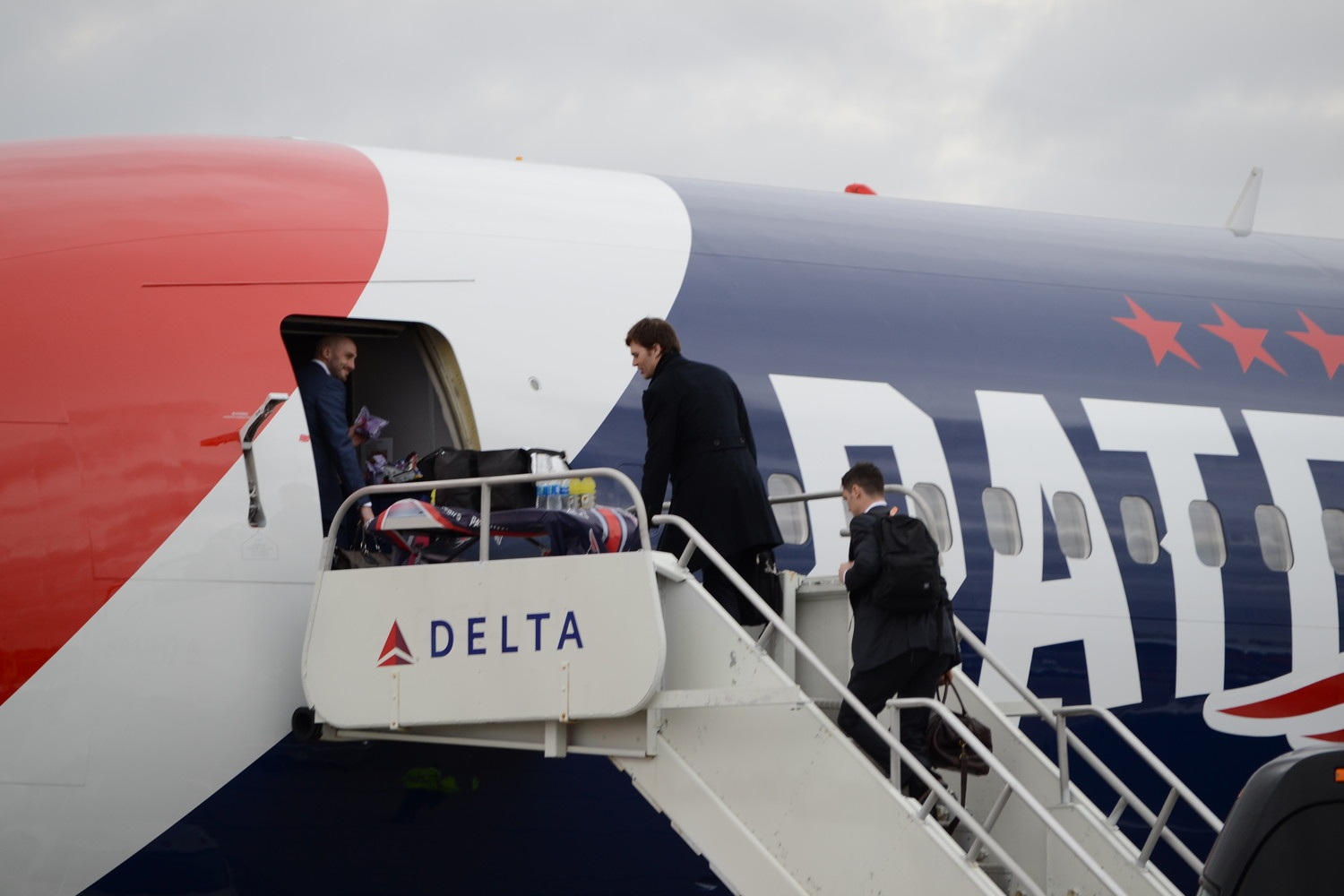 Brian Hoyer, Tom Brady and Chris Hogan make their way onto the Patriots plane at T.F. Green Airport en route to Minneapolis for Super Bowl 52 on Monday, Jan. 29.