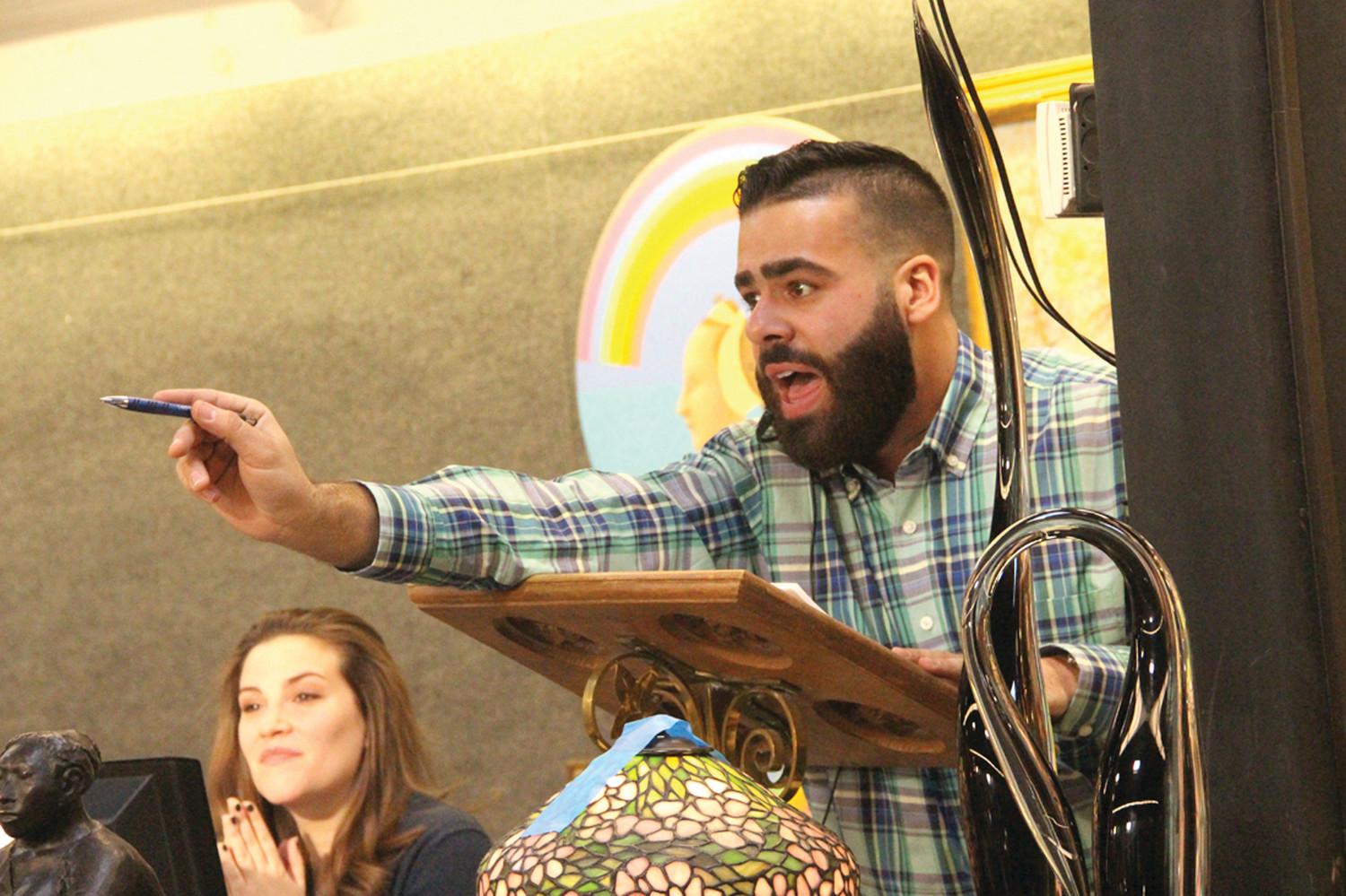 AUCTIONEER: Travis Landry, a specialist and auctioneer at Bruneau & Co., works Saturday's auction.