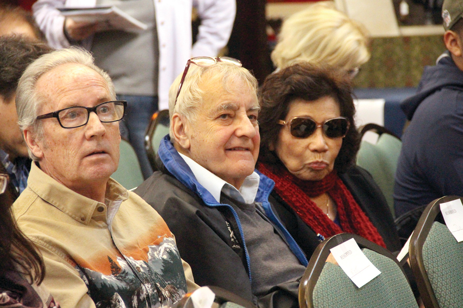FOLLOWING THE BIDS: Philanthropist Alan Shawn Feinstein (right) and his friend, Roy Beye, at Saturday's auction at Bruneau & Co. Auctioneers.