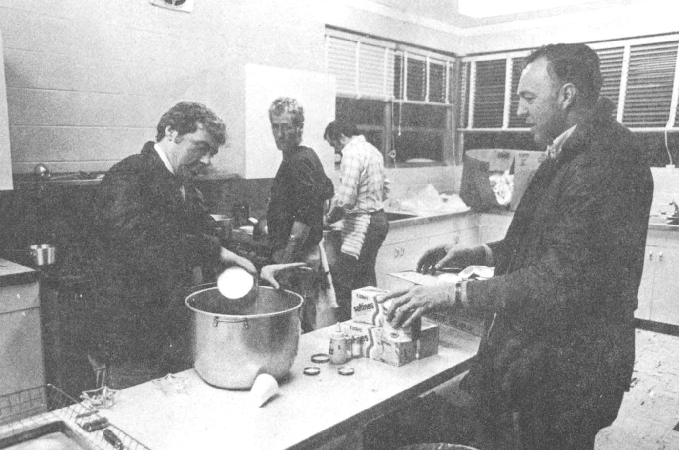 REFUGE FROM THE STORM: Mayor Joseph Walsh and Everett Carlow stir up beef stew at the Warwick Central Baptist Church shelter.