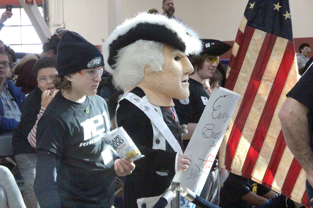 THE PATRIOTS PLAYED: The Pilgrim High mascot, aka Brandon Phillips, was there to root for the team at the 12 annual FIRST (For Inspiration and Recognition of Science and Technology) Tech Challenge Saturday hosted by the New England Institute of Technology.