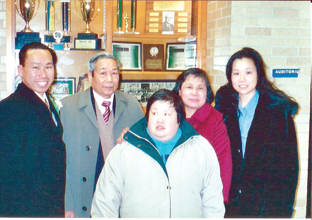 PROUDEST MOMENT: Mayor Allan Fung said that getting sworn into office as Cranston's Mayor in 2009 was one of the proudest moments he can remember for his father, Kwong-Wen, and mother, Tan Ping (second from right).