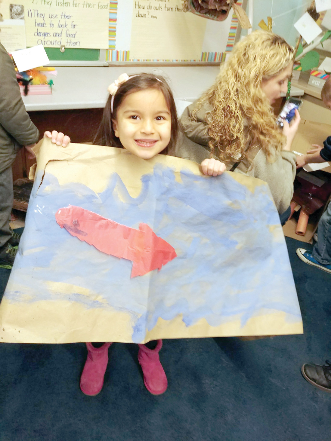 SALMON MIGRATION: Victoria Wikiel shows off her artistic creation depicting salmon and a river.