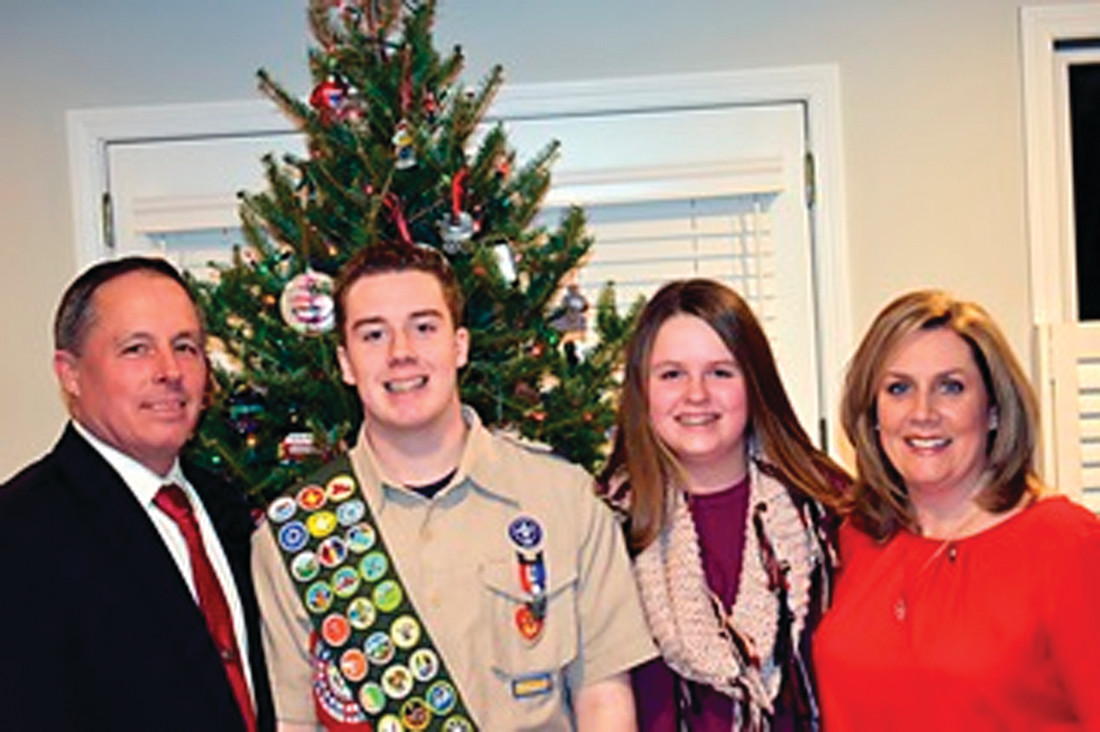 PROUD FAMILY: Kevin Cloxton accepts his Eagle Scout award in December alongside father David, sister Caroline, and mother Katie.