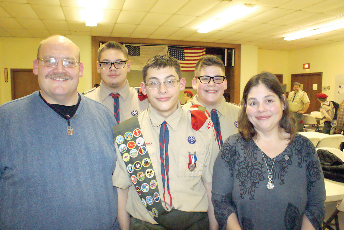 NEW EAGLE TAKES FLIGHT: On Feb. 3, the Bombardier family of Cranston celebrated their son Nicholas' Eagle Court of Honor at Woodridge Congregational Church. Bombardier, of Troop 66 Garden City, is the 153rd Eagle Scout from the troop. Nicholas is pictured with (back row) his brothers Matthew, who is a Star Scout and Dillon is a Frist Class Scout along with their parents, Amanda and Jay Bombardier.