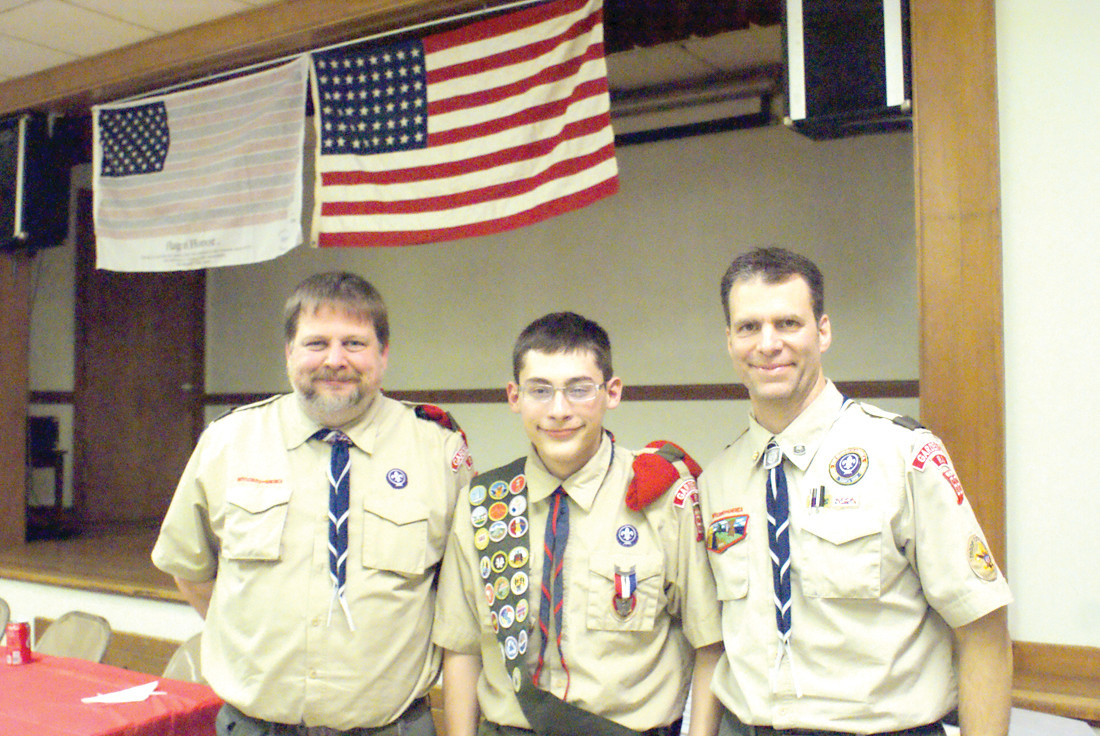 GOOD GUIDANCE: New Eagle Scout, Nicholas Bombardier, is pictured with (left) Scout Master of Troop 66 Garden City Jeff Goldthwaite and (right) Steve Parenteau, Troop 66 Committee Chairman and Nicholas' mentor. During the ceremony, Nicholas presented Parenteau with a Mentor's Pin.