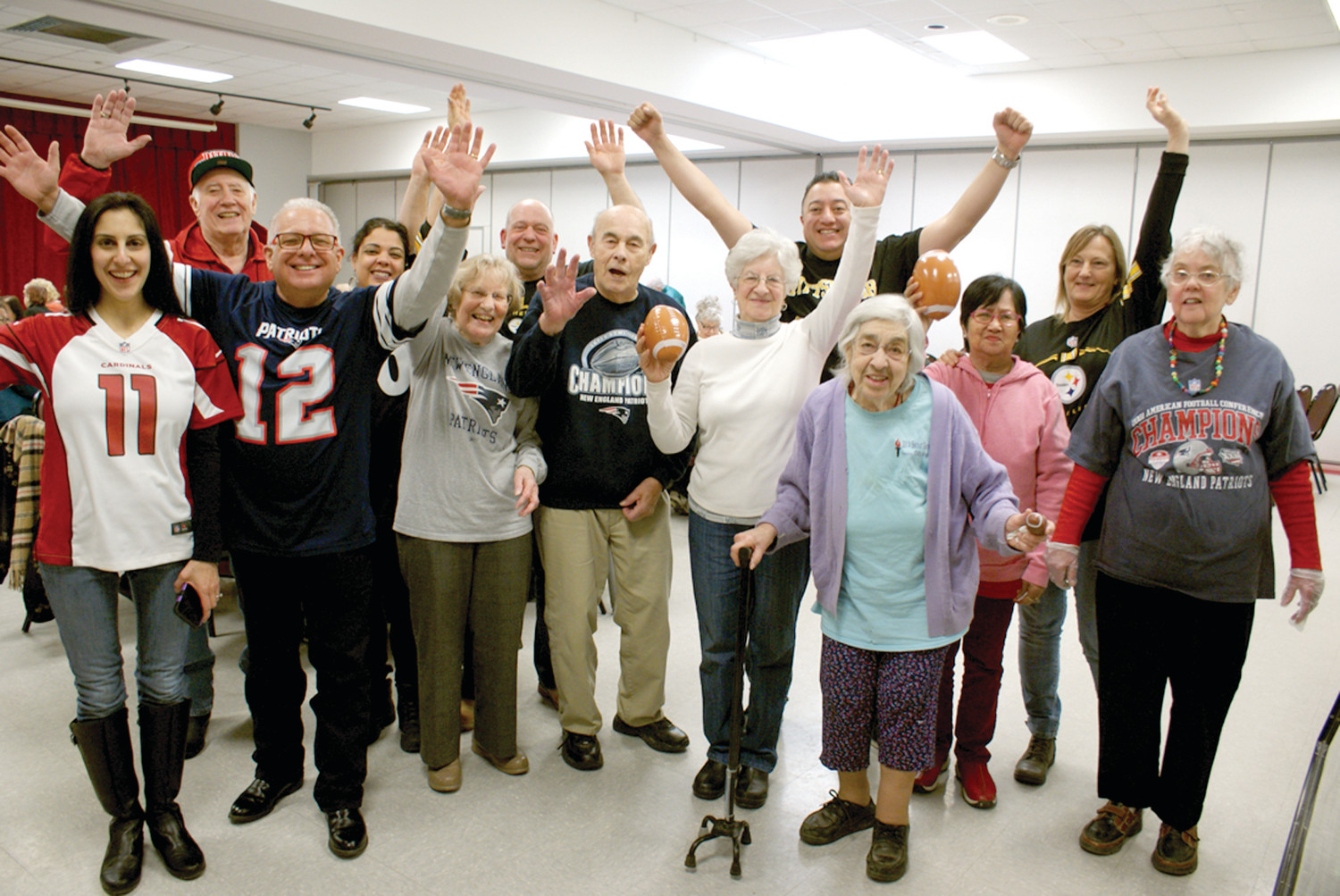 SUPER BOWL FUN AT SENIOR CENTER: On Feb. 3, Cranston Senior Center, held a Show Your Colors for some Super Bowl fun luncheon. Pictured are members of the staff, members and raffle prize winners with Jeffrey Barone, Executive Director of Cranston Senior Center pictured in his #12 Tom Brady shirt.