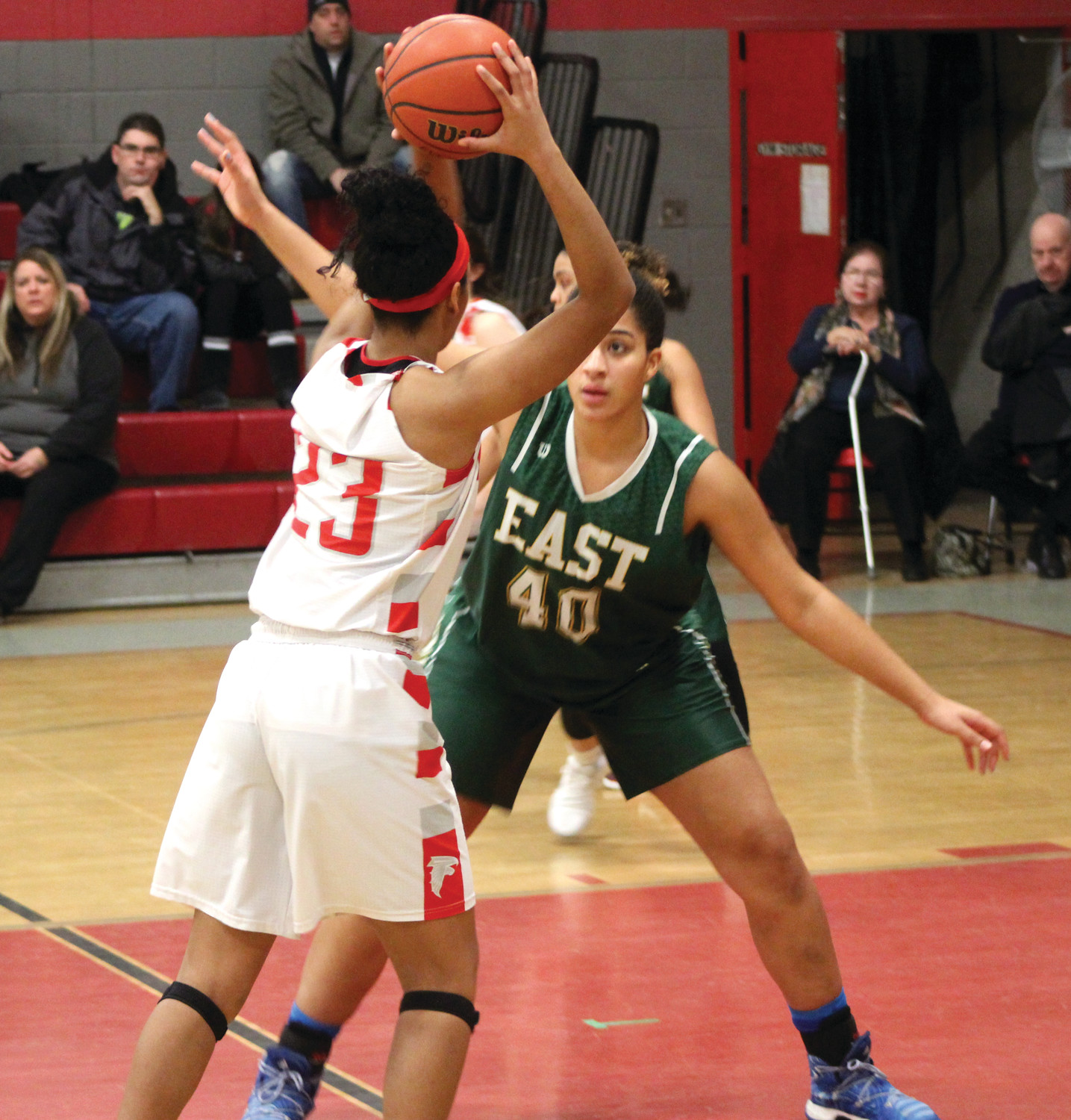 East's Maia Caito guards West's Mia James during the first half.