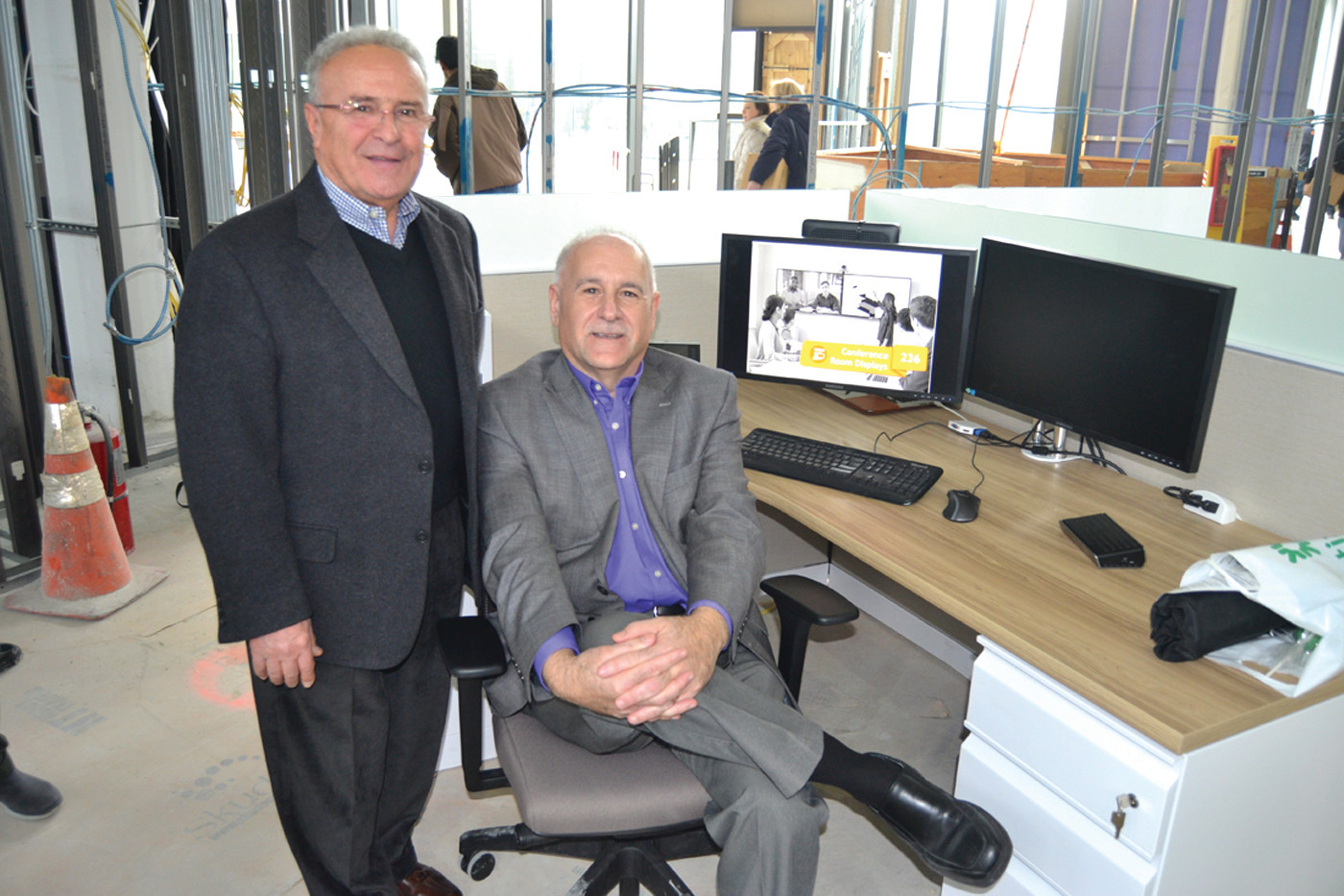 North Providence Mayor Mayor Charles Lombardi and Johnston Mayor Joseph Polisena try out proposed office furniture.