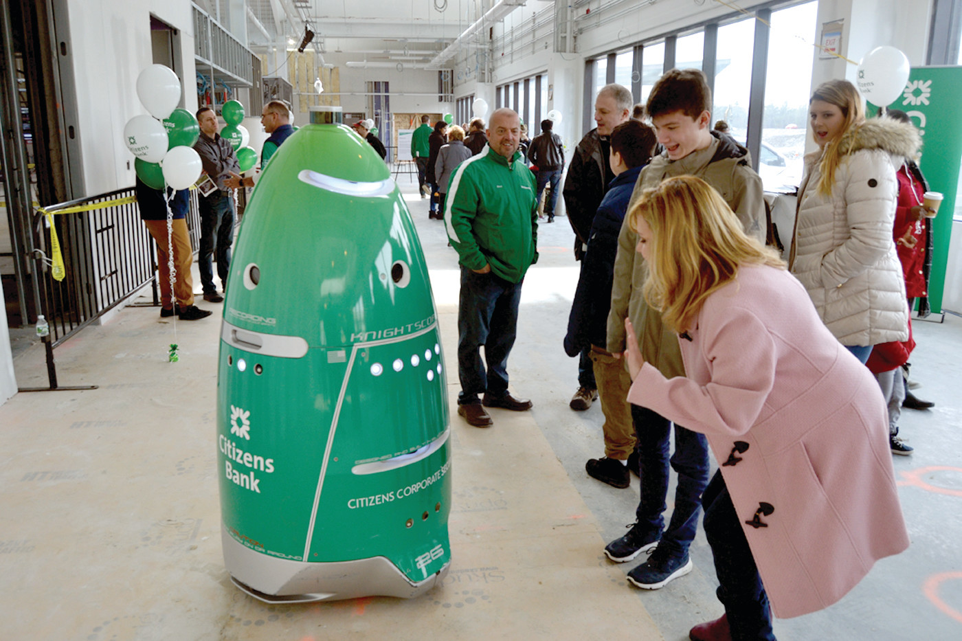 ROBOT SECURITY: This green security robot will be programmed to patrol the grounds and to interact with people as it makes its way around the Citizens Campus.  (Johnston Sun Rise photo by Tim Forsberg)