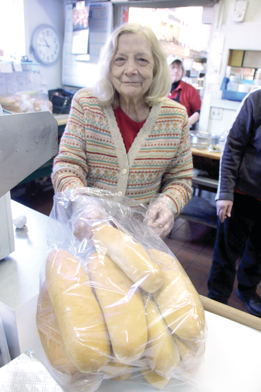 MAKING READY: Nancy Longiaru prepares rolls for Friday's lunch crowd at the Sandwich Junction. The shop was jamming and they made an estimated 200 sandwiches.