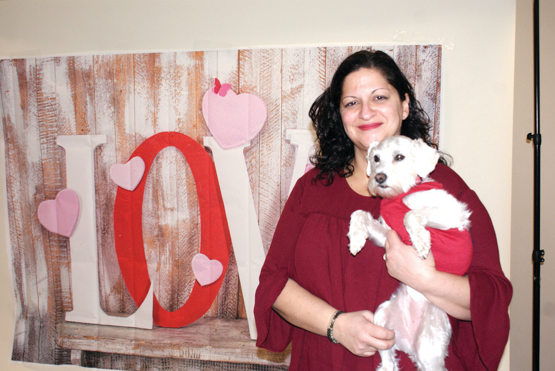 WITH LOVE: Pictured is Linda Del Vecchio-Gilbert, DNP, CPNP-PC, ACHPN, Director and Pediatric Nurse Practitioner as well as owner of Magnolia Pediatrics in Johnston. Her practice focuses on palliative care for children with chronic illnesses. She is pictured holding Magnolia Pediatrics service dog, Ruby Magnolia, who is a Schnoodle and works to comfort children under care. The event was held at the Cranston Christian Fellowship on Scituate Ave. and spread Valentine's fun to all those who attended.