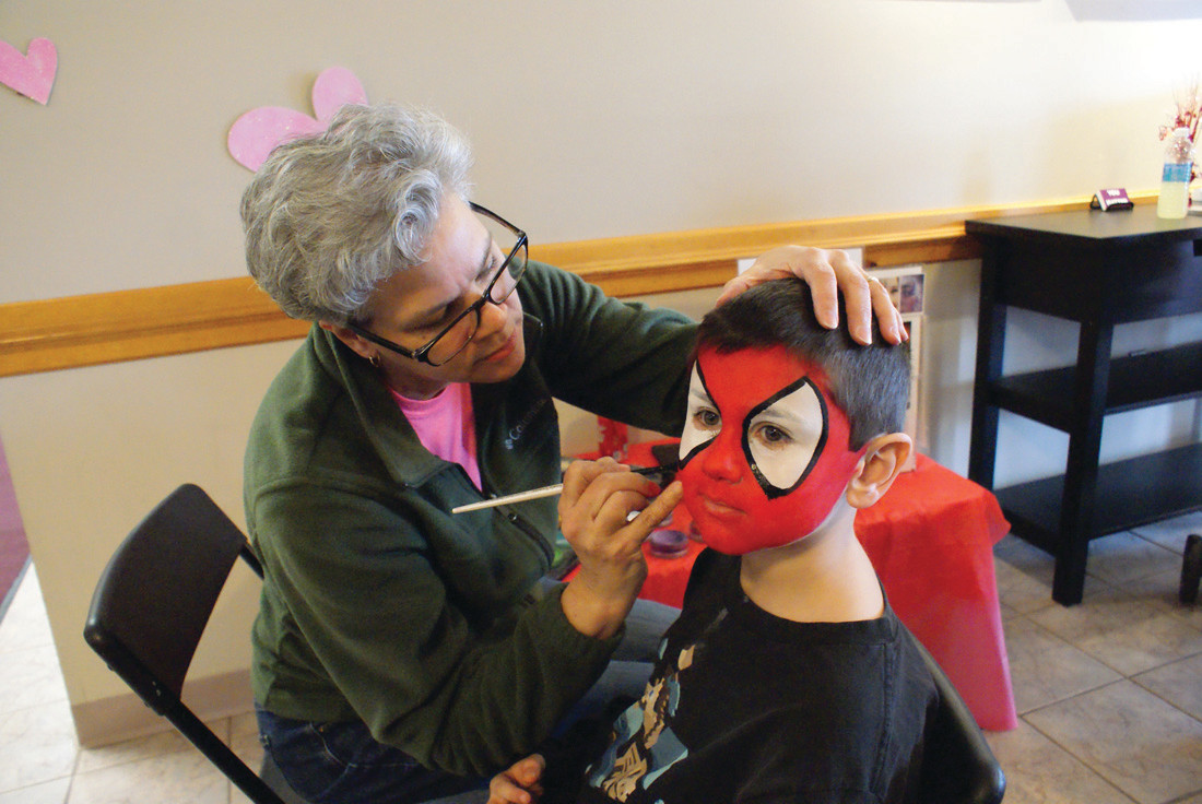 SPIDER-MAN: Young Christian Daglieri, age 6, enjoyed his face painting session with a volunteer face painter during the 2nd Annual Magnolia Valentine's Day Family Celebration, hosted by Magnolia Pediatrics of Johnston on Feb. 10. and held at the Cranston Christian Fellowship on Scituate Ave.