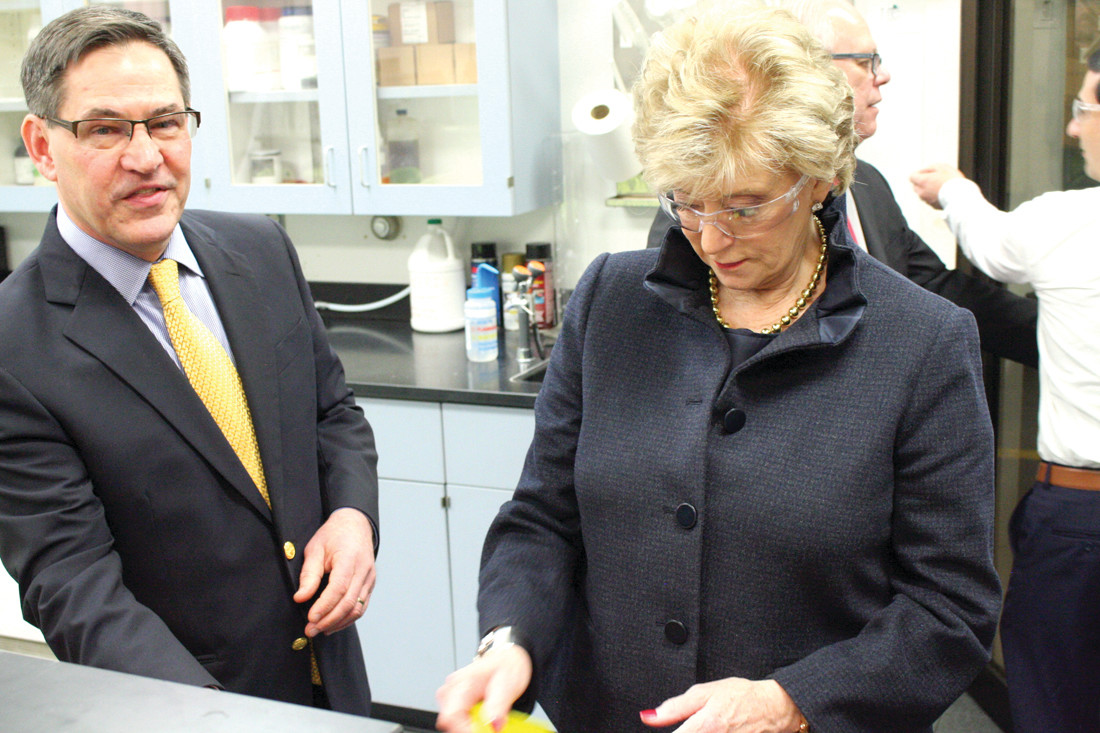 FACTORY TOUR: Linda McMahon, head of the Small Business Administration, is shown around the factory by President and COO of Mearthane, Peter Kaczmarek.