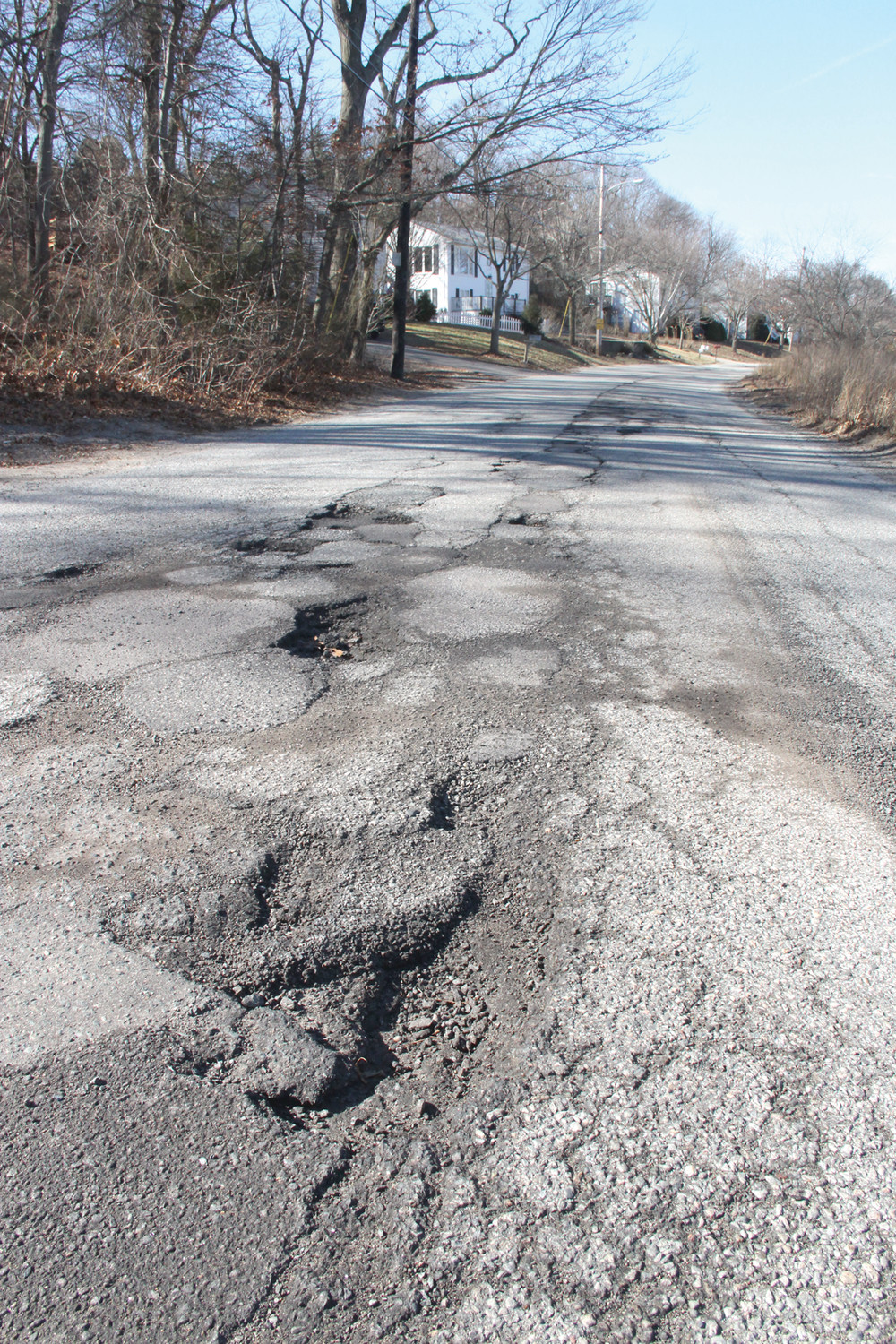 BREAKING APART: This section of Arnold's Neck Road is rife with potholes.