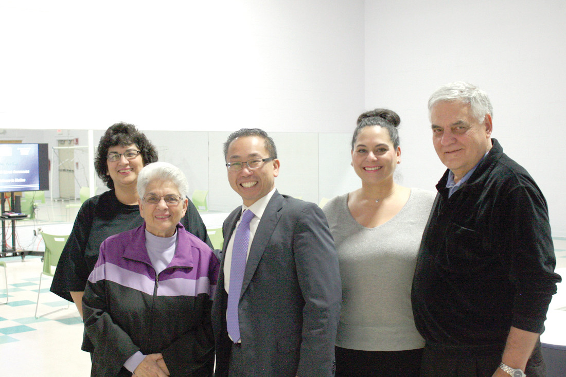 FAMILY AFFAIR: (From left) Donna Anderson, Marie Perna, Mayor Allan Fung, Anne DelSignore and Don Perna stand in the new activities room for the Dream Center in the Pastore building.