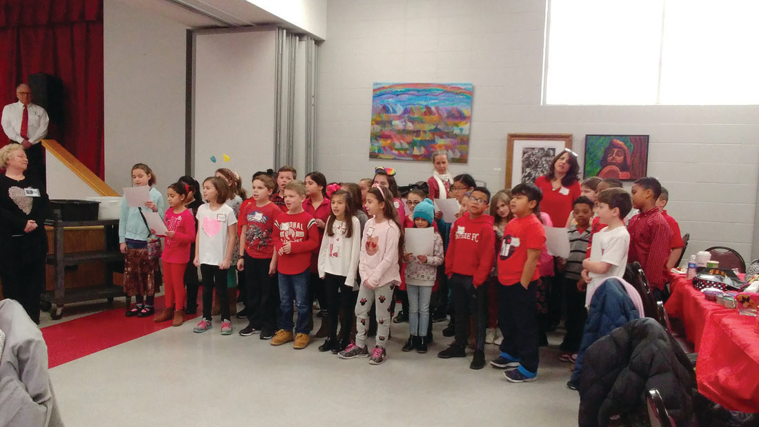 A SONG ABOUT KINDNESS: The entire group of third-graders from both schools sang a song about kindness to the senior citizens during their Valentine's Day visit.