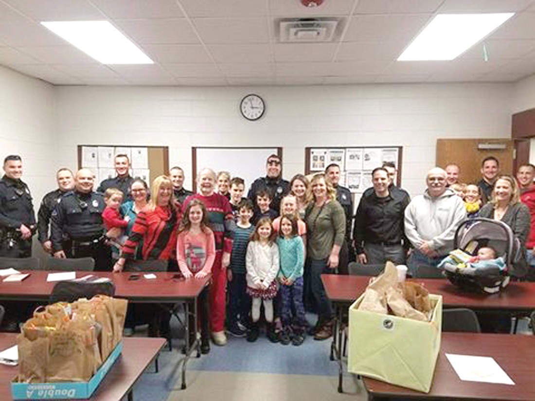 SPECIAL DELIVERY: On Tuesday, more than a dozen Faith Baptist parishioners, including children, delivered 220 bags of cookies to the Warwick Police Department.