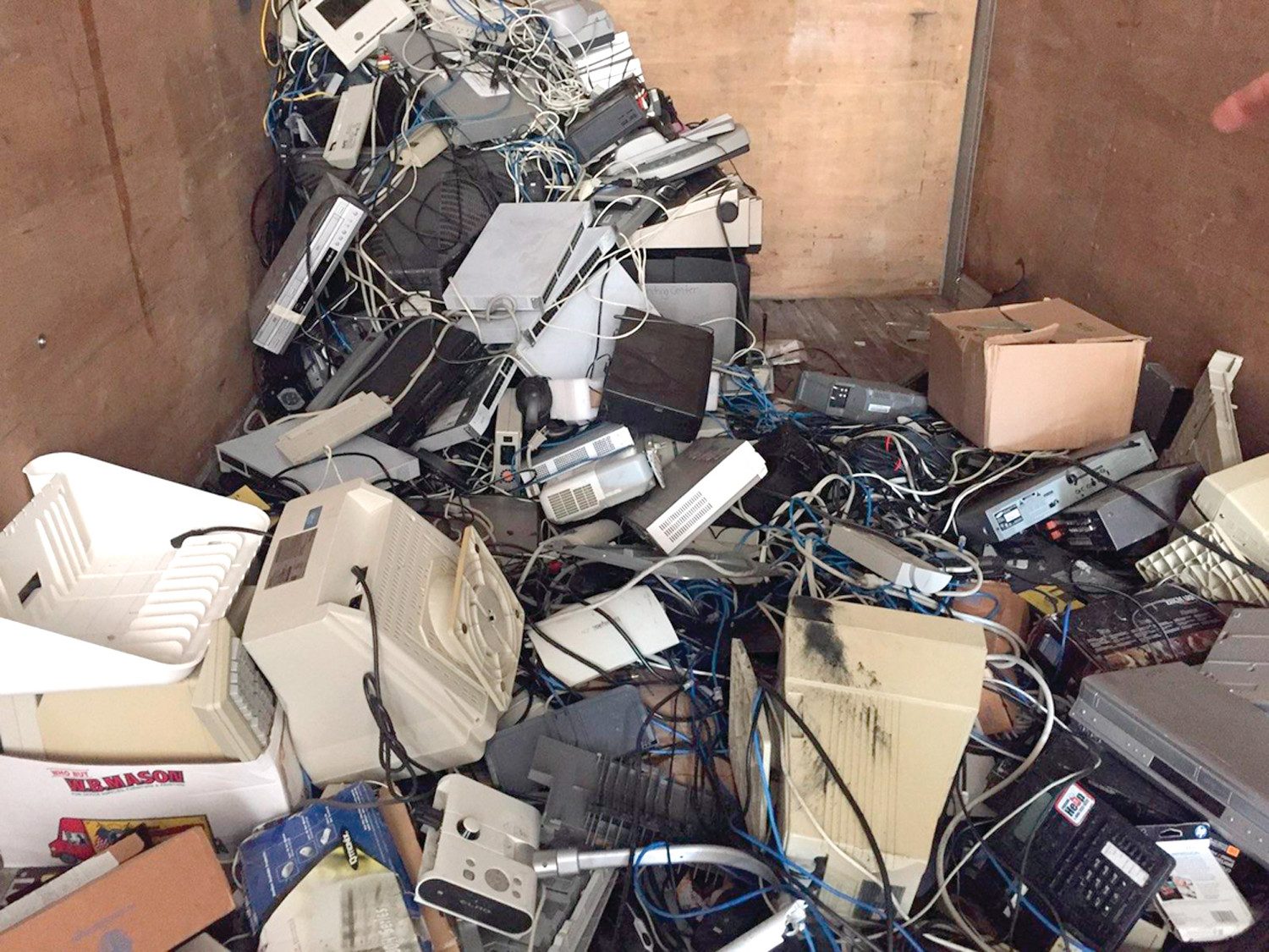ONE MAN'S TRASH…: Darlene Netcoh shared a picture of a storage container behind Toll Gate High School that was piled with e-wasted technology, some of which she said was purchased as recently as 2016.