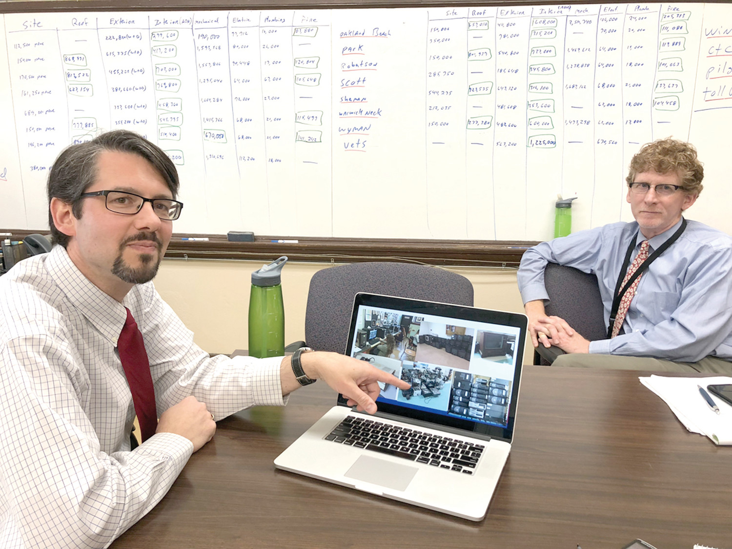 THE WHY AND HOW: Superintendent Philip Thornton (right) and technology director Doug Alexander (left), along with Anthony Ferrucci, finance director (not pictured), gave the reasoning behind the e-wasting policy and how it is carried out.