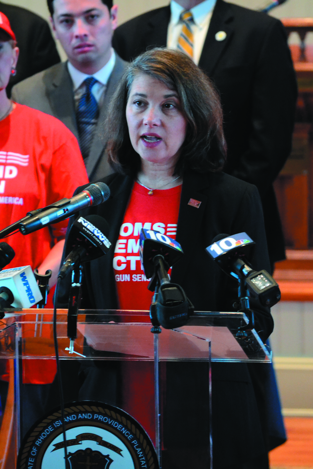 ACTION URGED: Jennifer Boylen, a volunteer advocate for the RI chapter of Moms Demand Action, a pro-gun control group that formed in the wake of Sandy Hook, speaks at the executive order signing on Monday.     (Warwick Beacon photos)