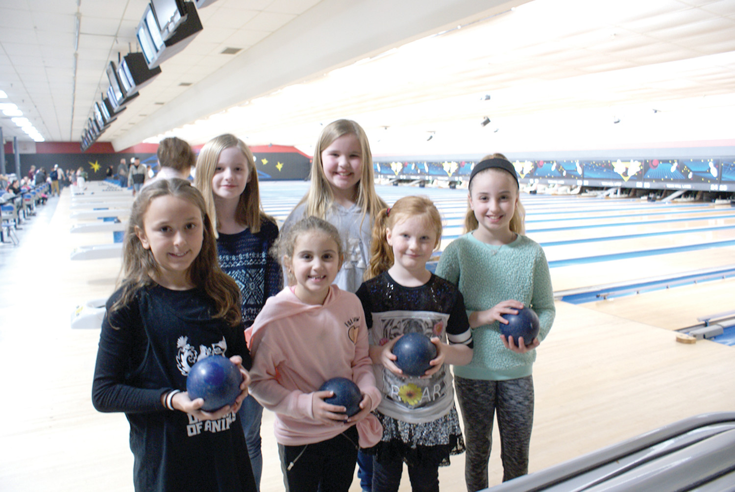 "READY TO BOWL: Pictured are just some of the children who bowled during the ""Bowling for Animals"" at Town Hall Lanes in Johnston. Back row is (l-r) Katie Caron-McCain, age 10 and her sister Josie, age 10. Front row (l-r) Madison Picchi, age 8; Daisy Tenaglia, age 7; Layla Crosby, age 6 and Maddie Tenaglia, age 10. (Sun Rise photos by Steve Popiel)"