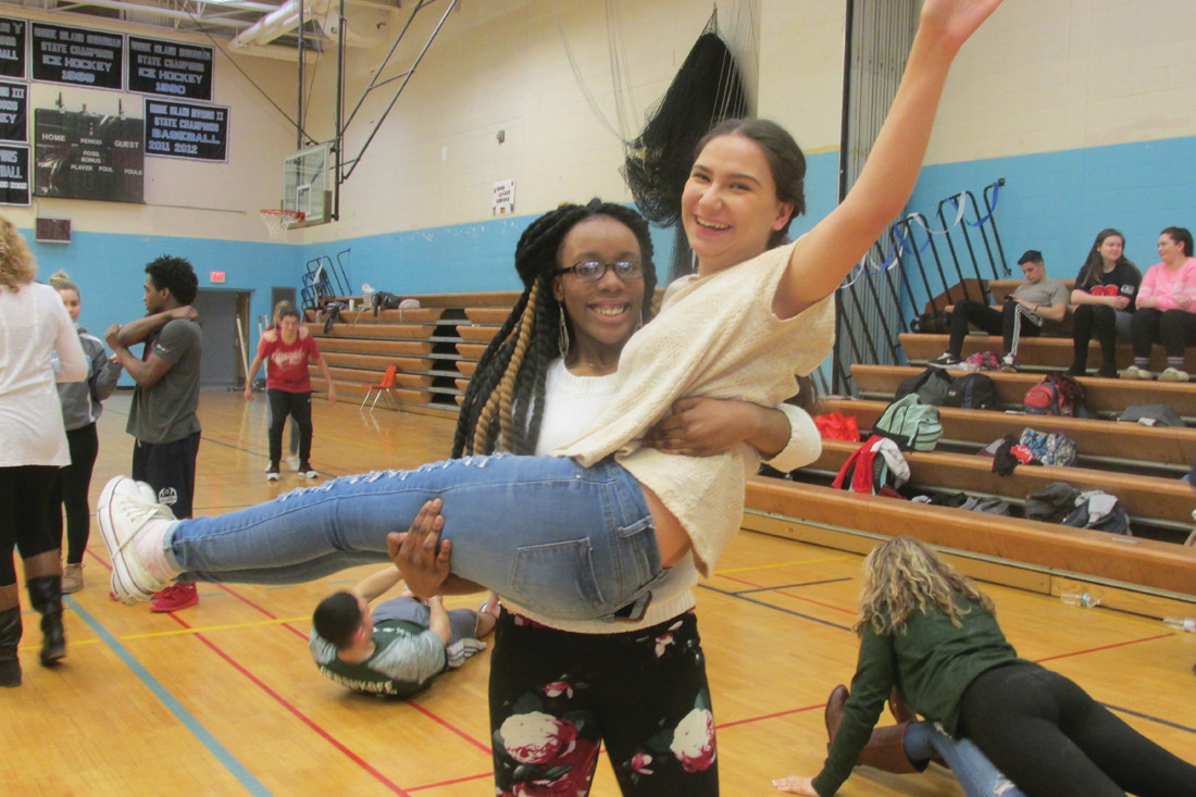 HEALTHY HEARTS: JHS student Ireaneus Wilson catches fellow Panther Abby Agnew (above left) who jumped in her arms during the recent Hoops for Heart event.